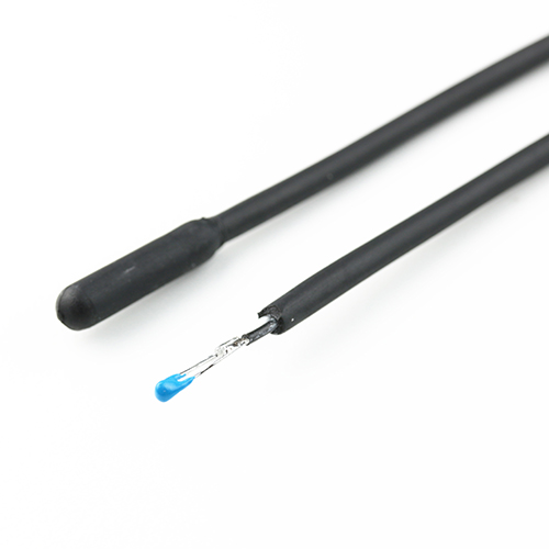 An unfinished NTC temperature probe with visible sensing element next to a finished NTC probe